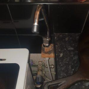 kitchen plumbing behind oven Emergency plumber